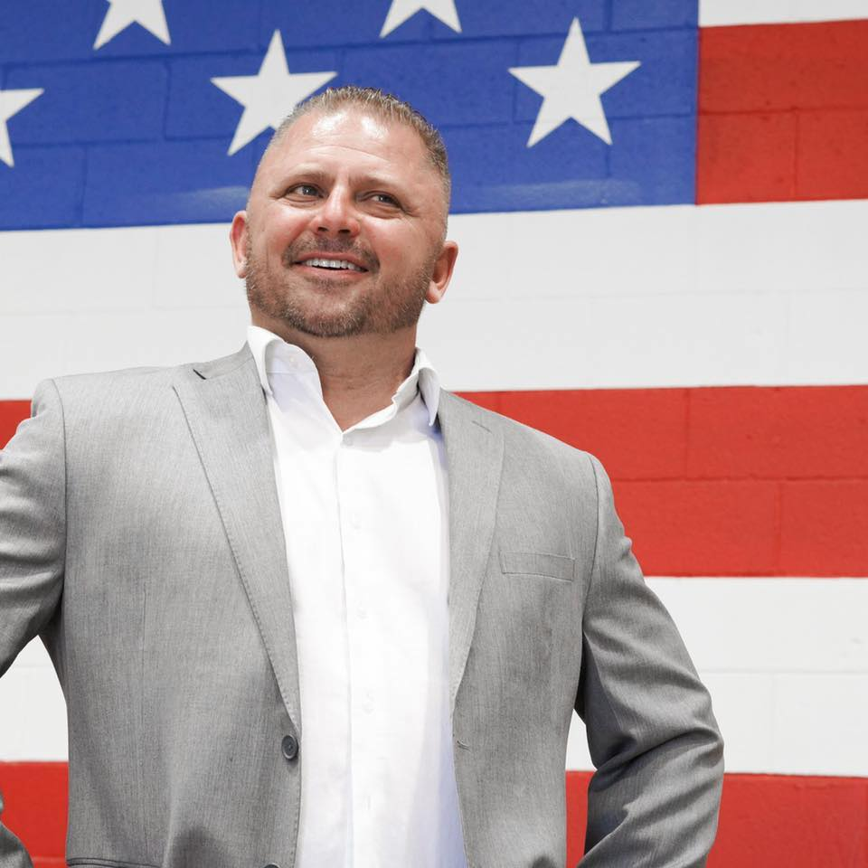 chris hock with american flag background