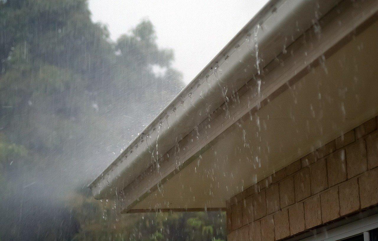 heavy rain on roof gutter